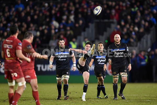 Freddie Burns of Bath Rugby kicks for touch. European Rugby Champions Cup match, between Bath Rugby and the Scarlets on January 12, 2018 at the Recreation Ground in Bath, England. Photo by: Patrick Khachfe / Onside Images