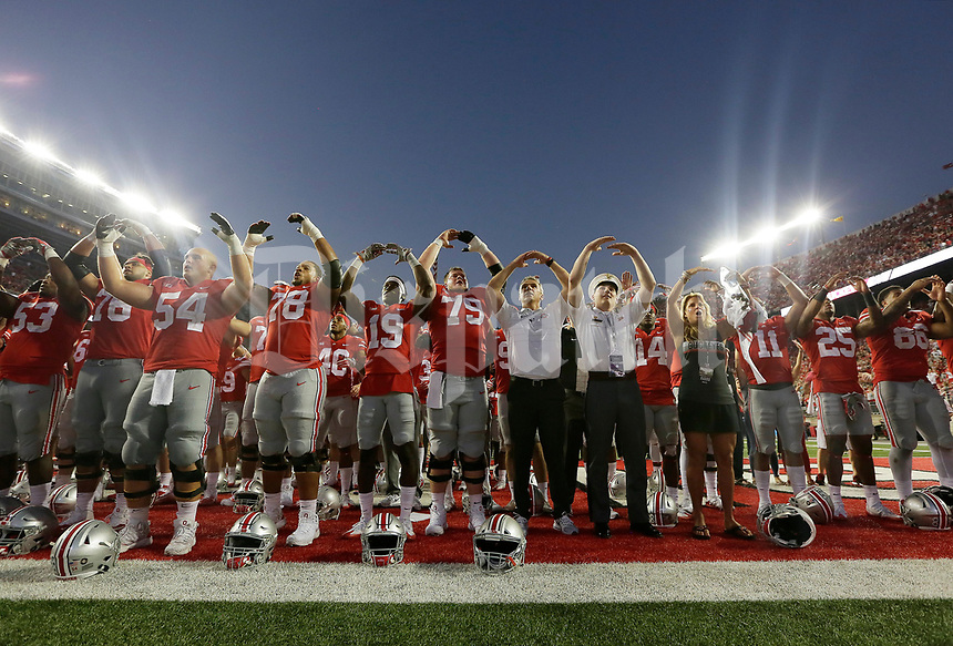"Ohio State Buckeyes players sing ""Carmen Ohio"" following the NCAA football game against the Army Black Knights at Ohio Stadium in Columbus on Sept. 16, 2017. Ohio State won 38-7. [Adam Cairns / Dispatch]"