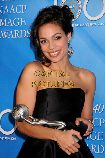 ROSARIO DAWSON.40th Annual NAACP Image Awards - Press Room at the Shrine Auditorium, Los Angeles, California, USA..February 12th, 2009.half length award trophy black strapless dress silk satin earrings dangling .CAP/ADM/BP.©Byron Purvis/AdMedia/Capital Pictures.