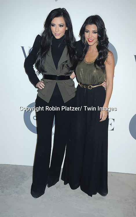 Kim Kardashian and Kourtney Kardashian attending The QVC and Vogue Fashion Week Party on February 11, 2011 at 229 West 43rd Street in New York City.