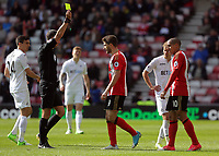 SUNDERLAND, ENGLAND - MAY 13: Fabio Borini of Sunderland (C) a yellow card by referee Andre Marriner for his foul against Matrin Olsson of Swansea City during the Premier League match between Sunderland and Swansea City at the Stadium of Light, Sunderland, England, UK. Saturday 13 May 2017
