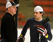 Ted Donato (Harvard - Head Coach) chats with Alex Killorn (Harvard - 19). The Harvard University Crimson hosted the Cornell University Big Red on Saturday, January 29, 2011, at Bright Hockey Center in Cambridge, Massachusetts.