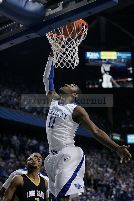 Freshman guard John Wall makes a dunk during the first half of the UK men's basketball against Long Beach State at Rupp Arena on Wednesday, Dec. 23, 2009. The Cats won 86-73 over the 49ers. Photo by Adam Wolffbrandt | Staff
