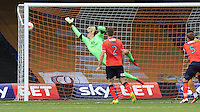 Luton Town keeper Christian Walton can not prevent Tom Eaves header from going into the back of the net during the Sky Bet League 2 match between Luton Town and Yeovil Town at Kenilworth Road, Luton, England on 13 August 2016. Photo by Liam Smith.