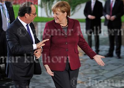 October 19-16,Bundeskanzleramt<br /> Normandie-Treffen im Kanzleramt <br /> Ankunft des französischen Präsidenten, François Hollande am Bundeskanzleramt<br /> Begrü&szlig;ung durch die Bundeskanzlerin<br /> <br /> 139/: EUROPA, DEUTSCHLAND,Portraitbild, Portraitfoto, GERMANY, DEUTSCHLAND, EUROPA, Model Release:No, Property Release:No, Persoenlichkeit, Portraet, Portraetaufnahme, Portraetbild, Portraetfoto, Portraets, Portraits<br /> Dagmar Kielhorn/imagetrust