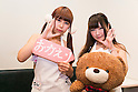 "Staff members Ten (18) (left) and Hime (19) pose for picture at the ""Ore no Yome"" cafe with a ""Welcome Home"" sign in Ikebukuro on November 4, 2015, Tokyo, Japan. ""Ore No Yome"" which literally means ''My Wife'' is one of the latest bizarre cafe concepts in Tokyo where wives wearing bikinis and an apron welcome you by your first name and serve drinks and dinner. The cafe is aimed at weary salarymen wanting a little comfort after work, although it also employs male staff who wear tight shorts and will act as your ""darling"" for the evening for female customers. According to the owner, the cafe will close its doors on Friday November 6, 2015, but there are still plenty of other bizarre establishments in the area. (Photo by Rodrigo Reyes Marin/AFLO)"