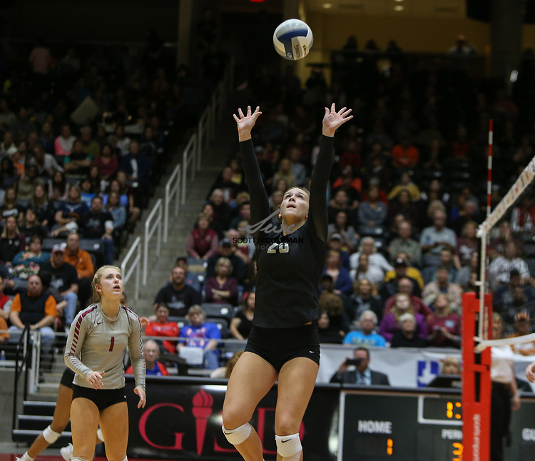Rouse Raiders senior Ava Bell (20) sets the ball during the Class 5A high school volleyball state final between Rouse High School and Prosper High School at Curtis Culwell Center in Garland, Texas, on November 18, 2017. Prosper won the match in five sets, (25-18, 21-25, 18-25, 25, 23, 16-14) to win the 5A state championship.