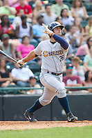Mike Ford (26) of the Charleston RiverDogs connects on what would be his second of four home runs against the Hickory Crawdads at L.P. Frans Stadium on May 25, 2014 in Hickory, North Carolina.  The RiverDogs defeated the Crawdads 17-10.  (Brian Westerholt/Four Seam Images)