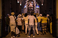 Havana, Cuba, sept 2014.During the day of the Virgin of the Charithy  Copper people prayng in front of the Statue. In recent years, Raul Castro has made several economic measures for the people of the island. Cubans can now buy and sell apartments or cars, can stay in hotels on the island and can travel abroad with minor difficulties. Most of the global economists believe that these changes are moving in the right direction but its positive effects on people are very slow. Cubans continue to struggle daily through the streets of Havana with humor and zest for life.                                  En los ultimos años Raul Castro ha realizado varias medidas economicas para el pueblo de la isla. Ahora los cubanos pueden comprar y vender departamentos o coches, pueden alojarse en hoteles de la isla y pueden viajar al extranjero con menores dificultades. La mayor parte de los economistas mundiales consideren que estos cambios se mueven en la justa direccion pero sus efectos positivos sobre la gente son muy lentos. Los cubanos siguen luchando a diario por las calles de La Habana con humorismo y ganas de vivir.