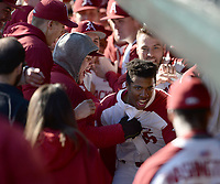 Arkansas center fielder Christian Franklin celebrates in the dugout Friday, Feb. 14, 2020, after hitting a 2-run home run during the fifth inning against Eastern Illinois at Baum-Walker Stadium in Fayetteville. Visit nwaonline.com/200214Daily/ for today's photo gallery.<br /> (NWA Democrat-Gazette/Andy Shupe)