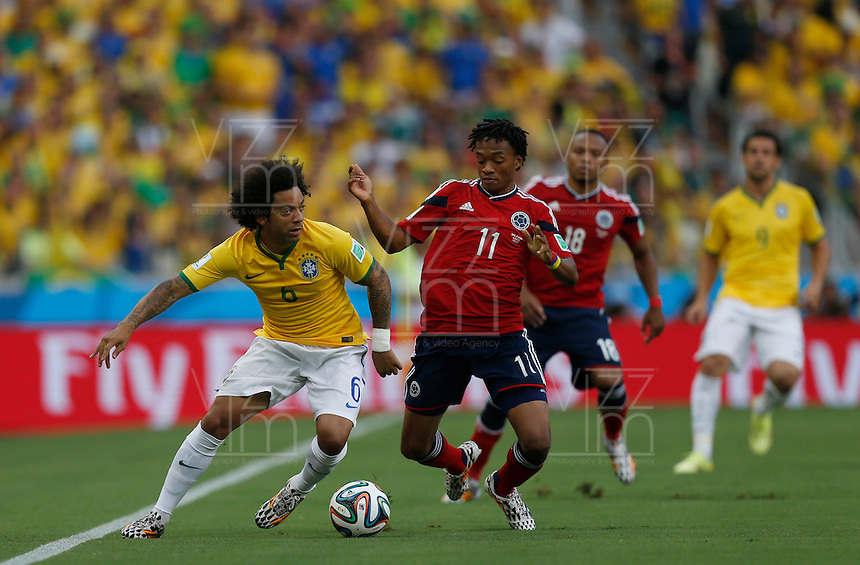 FORTALEZA - BRASIL -04-07-2014. Foto: Roberto Candia / Archivolatino<br /> Juan Cuadrado (#11) jugador de Colombia (COL) disputa un balón con Marcelo (#6) jugador de Brasil (BRA) durante partido de los cuartos de final por la Copa Mundial de la FIFA Brasil 2014 jugado en el estadio Castelao de Fortaleza./ Juan Cuadrado (#11) player of Colombia (COL) fights the ball with Marcelo (#6) player of Brazil (BRA) during the match of the Quarter Finals for the 2014 FIFA World Cup Brazil played at Castelao stadium in Fortaleza. Roberto Candia / Archivolatino<br /> VizzorImage PROVIDES THE ACCESS TO THIS PHOTOGRAPH ONLY AS A PRESS AND EDITORIAL SERVICE IN COLOMBIA AND NOT IS THE OWNER OF COPYRIGHT; ANOTHER USE IS REPONSABILITY OF THE END USER. NO SALES, NO MERCHANDASING. ALL COPYRIGHT IS ARCHIVOLATINO