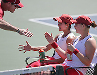 STANFORD, CA - April 1, 2011:  Hilary Barte and Mallory Burdette are congratulated by Associate Head Coach Frankie Brennan during Stanford's 6-1 victory over Arizona State at Stanford, California on April 1, 2011.