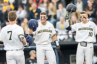 Michigan Wolverines outfielder Jonathan Engelmann (2) and teammate Blake Nelson (10) celebrate at the plate with Jesse Franklin (7) after his first inning home run against the Maryland Terrapins on April 13, 2018 in a Big Ten NCAA baseball game at Ray Fisher Stadium in Ann Arbor, Michigan. Michigan defeated Maryland 10-4. (Andrew Woolley/Four Seam Images)