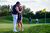Phil Mickelson (USA) and his wife Amy embrace following Phil's birdie putt to win the match on 18 during round 2 Four-Ball of the 2017 President's Cup, Liberty National Golf Club, Jersey City, New Jersey, USA. 9/29/2017.<br /> Picture: Golffile | Ken Murray<br /> <br /> All photo usage must carry mandatory copyright credit (&copy; Golffile | Ken Murray)