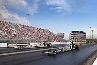 Aug. 31, 2013; Clermont, IN, USA: NHRA top fuel dragster driver Shawn Langdon (near lane) races alongside Brittany Force during qualifying for the US Nationals at Lucas Oil Raceway. Mandatory Credit: Mark J. Rebilas-