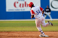 27 September 2009: Alfredo Despaigne of Cuba runs the bases after a record 11th home run to cut the margin to 10-6 in the eighth inning during the 2009 Baseball World Cup gold medal game won 10-5 by Team USA over Cuba, in Nettuno, Italy.