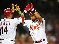 Apr. 25, 2011; Phoenix, AZ, USA; Arizona Diamondbacks outfielder Chris Young (right) is congratulated by Ryan Roberts  after hitting a two run home run in the third inning against the Philadelphia Phillies at Chase Field. Mandatory Credit: Mark J. Rebilas-