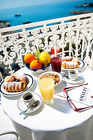 Breakfast served on a terrace overlooking the turquoise waters of the Amalfi Coast, Amalfi, Italy