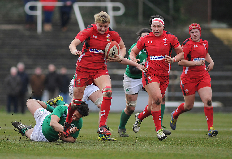 Wales&rsquo; Rachel Taylor evades the tackle of Ireland&rsquo;s Sophie Spence <br /> <br /> Photographer Kevin Barnes/CameraSport<br /> <br /> International Womens Rugby Union - 2015 Women&rsquo;s RBS Six Nations - Wales Women v Ireland Women - Sunday 15th March 2015 - St Helen's - Swansea<br /> <br /> &copy; CameraSport - 43 Linden Ave. Countesthorpe. Leicester. England. LE8 5PG - Tel: +44 (0) 116 277 4147 - admin@camerasport.com - www.camerasport.com
