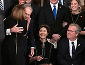 United States House Minority Leader Nancy Pelosi (Democrat of California) and former United States President George W. Bush share a hug during the ceremony honoring former United States President George H.W. Bush, who will Lie in State in the Rotunda of the US Capitol on Monday, December 3, 2018.  Looking on are former first lady Laura Bush and former Governor Jeb Bush (Republican of Florida).<br /> Credit: Ron Sachs / CNP<br /> (RESTRICTION: NO New York or New Jersey Newspapers or newspapers within a 75 mile radius of New York City)