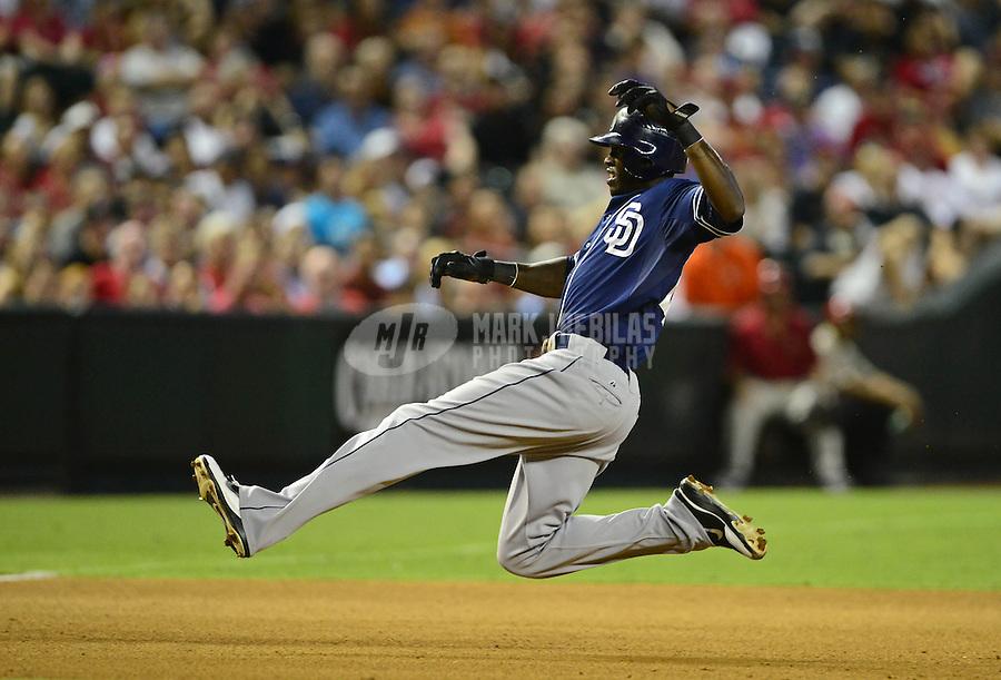 Jul. 3, 2012; Phoenix, AZ, USA: San Diego Padres outfielder Cameron Maybin slides safely into third base in the fourth inning against the Arizona Diamondbacks at Chase Field. Mandatory Credit: Mark J. Rebilas-