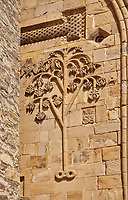 Pictures & images of the Church of the Assumption exterior bas relief Georgian stone work of the tree of life,1689, Ananuri castle complex & Georgian Orthodox churches, 17th century, Georgia (country).<br /> <br /> Ananuri castle is situated next to the Military Road overlooking the Aragvi River in Georgia, about 45 miles (72 kilometres) from Tbilisi. It was the castle of the eristavis (Dukes) of Aragvi from the 13th century and was the scene of numerous battles. In 2007 Ananuri castle was enscribed on the   UNESCO World Heritage Site tentative list.