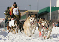 Matt Calore's team charges down 4th Avenue in Anchorage on Saturday March 1st during the ceremonial start day of the 2008 Iidtarod Sled Dog Race.