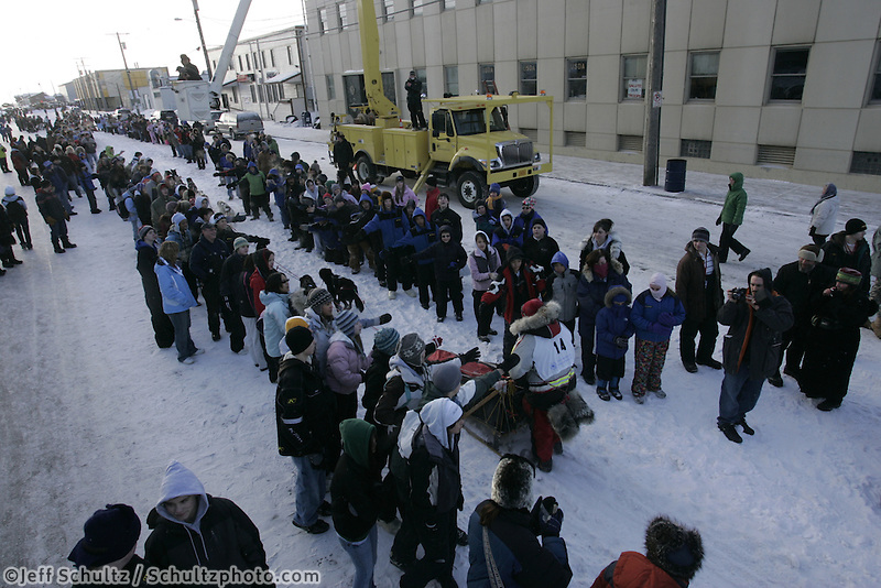 Ramy Brooks weaves through the crowd of spectators on Front Street at the start of the  2008 All Alaska Sweepstakes Sled Dog Race on Wednesday morning.  .Nome, Alaska