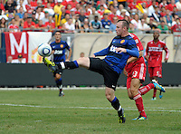 Manchester United forward Wayne Rooney (10) chips the ball over Chicago Fire goalkeeper Jon Conway (not pictured) to score Manchester United's first goal.  Manchester United defeated the Chicago Fire 3-1 at Soldier Field in Chicago, IL on July 23, 2011.