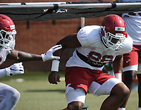 NWA Democrat-Gazette/ANDY SHUPE<br /> Arkansas defensive lineman Jamario Bell (right) runs Tuesday, Aug. 6, 2019, during practice at the university practice field. Visit nwadg.com/photos to see more photographs from the practice.