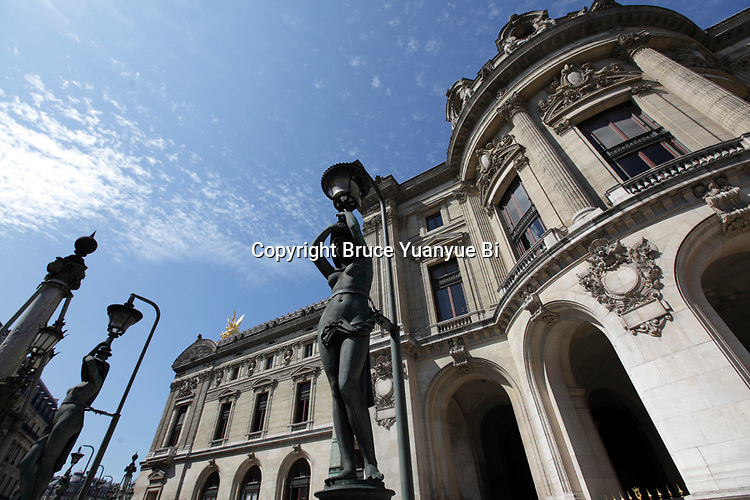 Statue-lampadaires outside of Opera Garnier. Palais Garnier. City of Paris. Paris