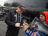 Sept 30, 2016; Mohnton, PA, USA; The car of NHRA top fuel driver Richie Crampton signs autographs during a rain delay to qualifying for the Dodge Nationals at Maple Grove Raceway. Mandatory Credit: Mark J. Rebilas-USA TODAY Sports