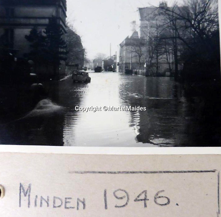 BNPS.co.uk (01202 558833)<br /> Pic: MartelMaides/BNPS<br /> <br /> Still flooded in 1946 - The remains of Minden, a devastating air raid by US B17s on 28 March 1945 almost completely destroyed the town centre, including the town hall and cathedral, and resulted in the death of over 180 people.<br /> <br /> A fascinating archive of photos that offer an insight into what postwar Germany was like just after the end of WW2 has come to light.<br /> <br /> The incredible album of 262 black and white pictures show the stark aftermath of the war - buildings reduced to rubble in the capital Berlin, a flooded town and an abandoned factory where the Germans made their deadly V-2 rockets.<br /> <br /> They are believed to have been taken by a British soldier who was with Allied forces administrating the war ravaged country a year after the end of hostilities.<br /> <br /> The archive is being sold by Martel Maides on Guernsey on June 9.