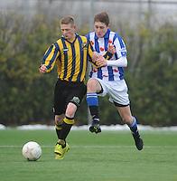 VOETBAL: HEERENVEEN: 23-11-2014, Sportpark Skoatterwâld, VV Heerenveen - Frisia, uitslag 2 - 0, Geoffrey Schilte (#18), Ivar Span (#12), ©foto Martin de Jong