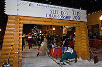 Volunteers help during the start of the UP 200 Sled Dog Championship race in downtown Marquette Michigan.