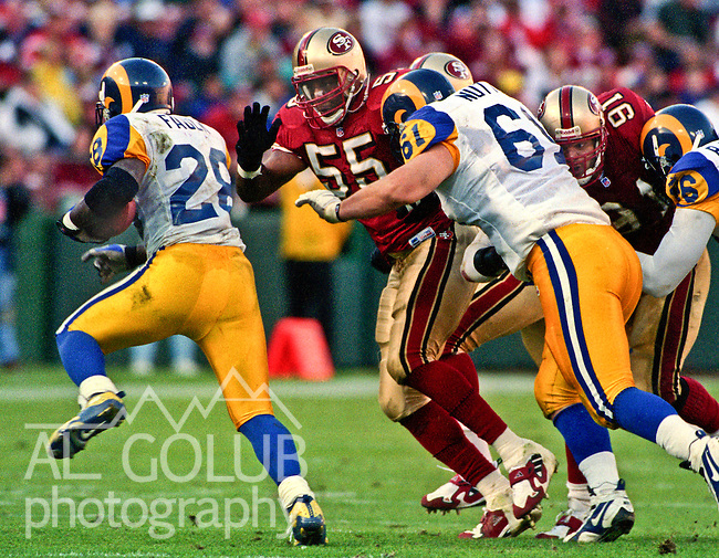 San Francisco 49ers vs. St. Louis Rams at Candlestick Park Sunday, November 21, 1999.  Rams beat 49ers 23-7.  San Francisco 49ers linebacker Winfred Tubbs (55) chases St. Louis Rams running back Marshall Faulk (28).