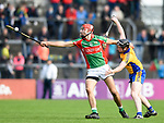Peter Duggan of Clooney-Quin in action against Jamie Shanahan of  Sixmilebridge during their senior county final replay at Cusack park. Photograph by John Kelly.