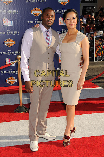 "Derek & Sophie Luke.""Captain America: The First Avenger"" Los Angeles Premiere held at the El Capitan Theatre, Hollywood, California, USA..July 19th, 2011.full length beige dress grey gray waistcoat shirt purple tie married husband wife trousers .CAP/ADM/BP.©Byron Purvis/AdMedia/Capital Pictures."