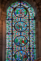 14th century medieval Gothic stained glass window showing scenes from the life of Saint Maurice (From Bottom Up) Saint Maurice refuses to sacrifice to false idols, Maurice is shown as the leader of the Roman Thebian Legion, The 2 emperors Diocletian and Maximian order the persecution of Christians, Maurice and his followers and executed.. The Gothic Cathedral Basilica of Saint Denis ( Basilique Saint-Denis ) Paris, France. A UNESCO World Heritage Site.