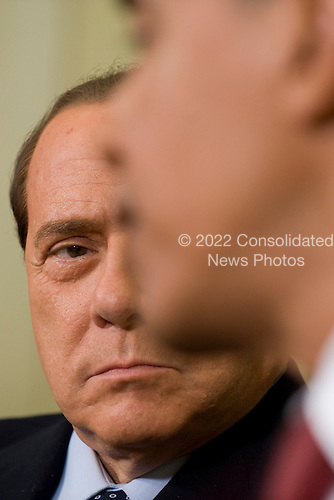 Washington, DC - June 15, 2009 -- Prime Minister Silvio Berlusconi (L) looks at United States President Barack Obama during a meeting in the Oval Office of the White House on Monday, 15 June 2009.  The two leaders met in advance of the G8 summit which will be held in Italy next month..Credit: Matthew Cavanaugh - Pool via CNP