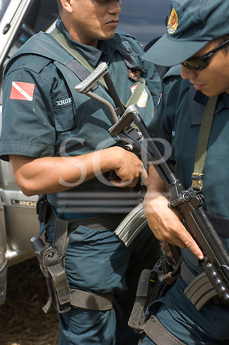 Para State, Brazil. Military police armed with semi-automatic rifles and pistols near Itaituba.