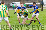 Lispole midfielder Noel Higgins manages to offload the ball despite pressure from Phillip Leahy and Eamon O'Reilly, Ballyhooly, during their sides clash in the Munster Junior B club football final in Knockaderry