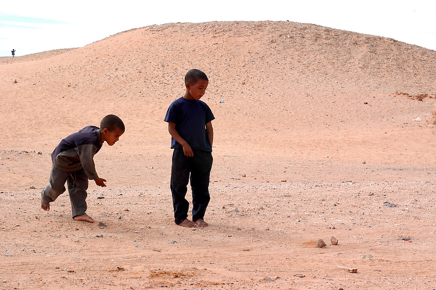 Children play on December 12, 2003, in the Saharawi refugee camps in Aljer. Saharawi people have been living at the refugee camps of the Algerian desert named Hamada, or desert of the deserts, for more than 30 years now. Saharawi people have suffered the consecuences of European colonialism and the war against occupation by Moroccan forces. Polisario and Moroccan Army are in conflict since 1975 when Hassan II, Moroccan King in 1975, sent more than 250.000 civilians and soldiers to colonize the Western Sahara when Spain left the country. Since 1991 they are in a peace process without any outcome so far. (Ander Gillenea / Bostok Photo)
