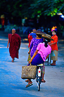Burmese women riding bicycle, Mandalay, Burma (Myanmar)