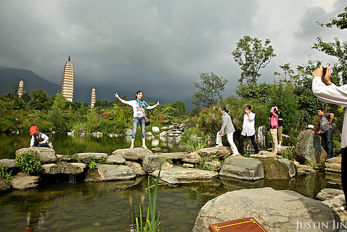 Tourists posing in front of the Three Pagodas in Dali, Yunnan province, southwestern China.