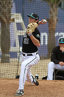Coastal Carolina Chanticleers pitcher Tyler Herb #27 throwing in the bullpen before a game against the Wichita State Shockers at Ticketreturn.com Field at Pelicans Ballpark on February 23, 2014 in Myrtle Beach, South Carolina. Wichita State defeated Coastal Carolina by the score of 5-2. (Robert Gurganus/Four Seam Images)
