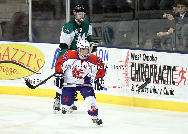 Cherry Creek's Dalton Walker (No. 24) and Medina's Eric Myles (No. 26). Cherry Creek (Colorado) beat Medina (Ohio) 5-1 on the third day of pool play during the 2014 High School Hockey National Championship in Omaha on March 28. (Photo by Michelle Bishop)
