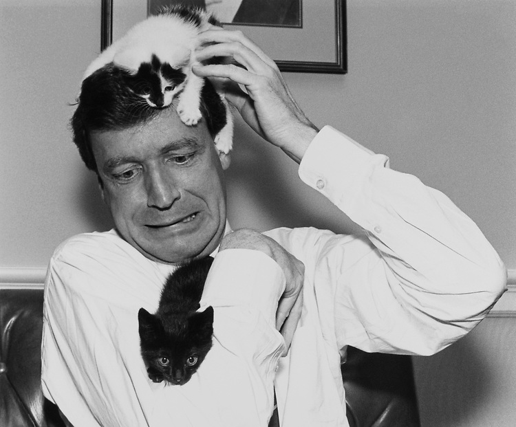 """Rep. Peter H. Kostmayer, D-Pa. with the new office kittens, black and white  Earl and black Huey, both named after Louisiana historical figures - """"both democrats politicians""""- according to Kostmayer in July, 1991. (Photo by Jamie Howren/CQ Roll Call)"""