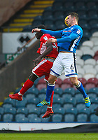 Rochdale's Harrison McGahey (right) jumps ahead of Walsall's Daniel Agyei (left) to head the ball during the Sky Bet League 1 match between Rochdale and Walsall at Spotland Stadium, Rochdale, England on 23 December 2017. Photo by Juel Miah / PRiME Media Images.
