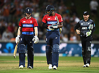 Eoin Morgan and Chris Jordan at the end of the innings.<br /> New Zealand Black Caps v England.Tri-Series International Twenty20 cricket. Eden Park, Auckland, New Zealand. Sunday 18 February 2018. &copy; Copyright Photo: Andrew Cornaga / www.Photosport.nz